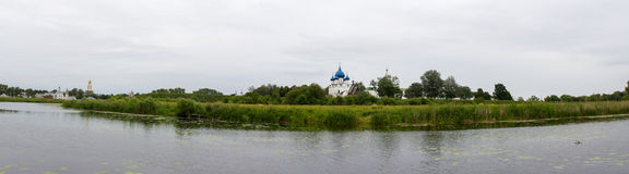 View of the Kremlin on the banks of the river Kamenka in Suzdal. Russia. Stock Photos