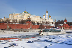 View of the Kremlin and the boat sailing along the Moskva river, Moscow, Royalty Free Stock Photo