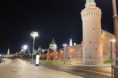 View of the Kremlin embankment and the wall of the Moscow Kremlin with towers in Moscow. 2017 year, city of Moscow, autumn night royalty free stock photo