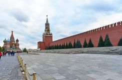 View of Kremlin`s Spasskaya tower and St. Basil the Blessed Cathedral. Red Square, Moscow. Russia. royalty free stock images