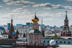 View of the Kremlin's Spassky Tower, and St. Basil's Cathedral of the morning with cumulus clouds Stock Images