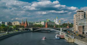 View of the Kremlin with tourist ships on the Moscow River stock footage