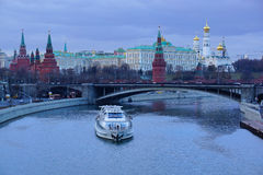 View of the Kremlin in the twilight.Moscow. Panorama of the Moscow Kremlin.pleasure boat and a Large Stone Brid Stock Photos