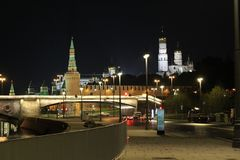 View of the Kremlin wall, Beklemishevskaya tower and the Church of Ivan the Great Bell Tower in Moscow. In the autumn, at night stock photography