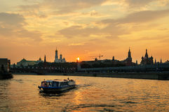 View of the Kremlin from the water at sunset Stock Image