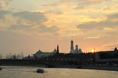 View of the Kremlin from the water at sunset Royalty Free Stock Images