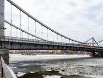 View of Krymsky Bridge over frozen Moskva River stock image