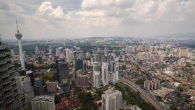 View of Kuala Lumpur city from Petronas Twin Towers. KUALA LUMPUR, MALAYSIA - 18TH FEBRUARY 2015; View from tower one of Petronas Twin Towers. The skyscrapers Royalty Free Stock Photos