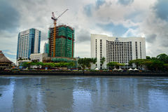 View of Kuching city waterfront and Hilton hotel Stock Photos