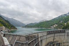 The view of Kurobe Dam. The Kurobe Dam or Kuroyon Dam is a variable-radius arch dam on the Kurobe River in Toyama Prefecture Royalty Free Stock Images