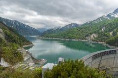 The view of Kurobe Dam. The Kurobe Dam or Kuroyon Dam is a variable-radius arch dam on the Kurobe River in Toyama Prefecture Stock Photos