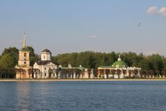 View of Kuskovo Park and historical architecture in Moscow Russia through the water channel on a spring day royalty free stock image