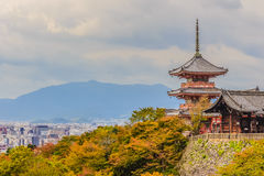View of Kyoto city from Kiyomizu temple with dramatic cloudy sky. On background Stock Photos