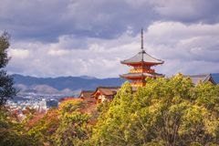 View of Kyoto and Kiyomizu-dera temple buildings in autumn. Iconic buildings at Kiyomizu-dera Buddhist Temple with the main Pagoda structure in the middle and royalty free stock photography