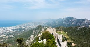 View of Kyrenia mountains and mediterranean coastline. View of Kyrenia mountain range and small Mediterranean town Girne Kyrenia from Saint Hilarion castle royalty free stock image