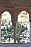 View at La Alhambra. La Alhambra interior windows, looking out upon the city center of Granada, Spain with mountains behind Stock Photography