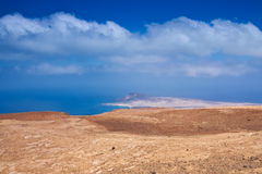 View of the La Graciosa island from a slant of Mount Mirador del Rio on background deep blue sky and Atlantic Ocean Royalty Free Stock Photography