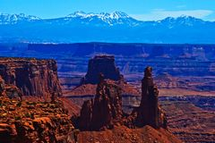 View of La Sal Mountains from Canyonlands with Washer Woman Arch. Canyonlands National Park, Utah, Desert Southwest, USA stock photography
