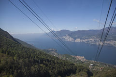 View of Lago di Garda from a cable-car to Monte Baldo. View of Lago di Garda from a cable-car, while traveling to Monte Baldo summit Royalty Free Stock Photos