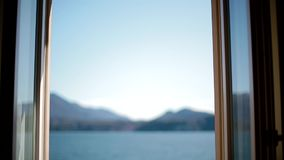View of Lago Maggiore through opening window stock video footage