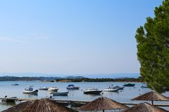 View of the lagoon and boat on sunshades Stock Photo