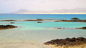 View on the lagoon on the island Lobos and the sand dunes in Cor Stock Photo