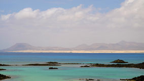 View on the lagoon on the island Lobos and the sand dunes in Cor Royalty Free Stock Photography