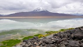 View of the Laguna Blanca with the peaks of the snow-capped volcanoes o stock photography