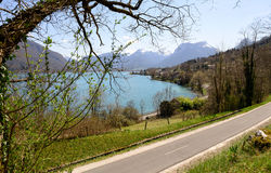 View of Lake of Annecy with the bike path Royalty Free Stock Photos