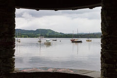 View of lake and boats via window in Lake Windermere Stock Photos