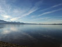View of lake chiemsee on a winter day. This picture shows the calm Chiemsee in a wonderful winter day Stock Image