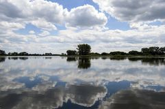 View of the lake and clouds reflecting in the water.  Royalty Free Stock Image