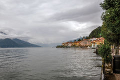 View of Lake Como in cloudy day with the buildings of Bellagio. Stock Photos