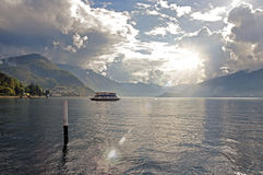 View of Lake Como in a cloudy day with sunshine in Bellagio. Royalty Free Stock Photos