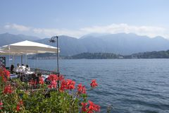 Panoramic view of Lake Como on a sunny day. View of Lake Como from a restaurant terrace on the west branch of the Lake Stock Image