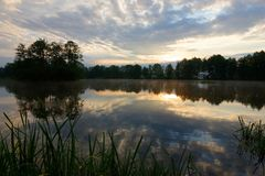 Lake. View on a lake durring cloudy sunrise Royalty Free Stock Image