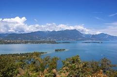 View on the lake Garda and the Alpes. View on the lake Garda, the Alpes mountains and small island, Italy Royalty Free Stock Photography