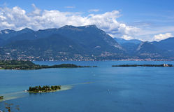 View on the lake Garda and the Alpes. View on the lake Garda, the Alpes mountains and small island, Italy Stock Photography
