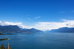 View on the lake Garda and the Alpes. View on the lake Garda, the Alpes mountains and small island, Italy Stock Images