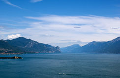 View on the lake Garda and the Alpes. View on the lake Garda, the Alpes mountains and small island, Italy Stock Photos
