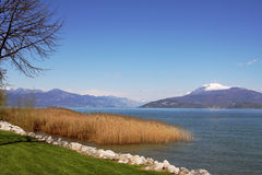 View on Lake Garda and mountains in Sirmione. Stock Photo