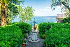 View on Lake Garda in Sirmione, Italy. Beautiful garden on Lake Garda in northern Italy stock photography