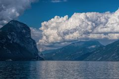 View of Lake Garda. And mountains on a cloudy day royalty free stock photos