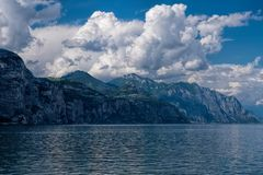 View of Lake Garda. And mountains on a cloudy day stock image