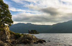 View of a Lake with a girl. In Scotland Royalty Free Stock Image