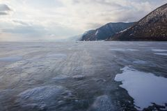View of lake with ice surface and rocks formations on shore ,russia, lake. Baikal royalty free stock photo