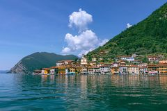 View from the lake of Iseo on the small town of Sulzano stock image