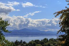 View on lake Leman. View on beautiful lake Leman from park in down town with big cloud and wonderful sky. City of Lausanne, canton Vaud, Switzerland Royalty Free Stock Images