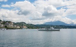 View on lake Lucerne, mountains and city Lucerne, Switzerland, Europe. Lucerne, Switzerland - July 3, 2017: View on lake Lucerne, mountains and city Lucerne stock images