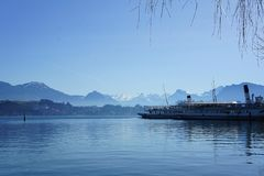 Steamships on a lake with the Alps in the background stock photos